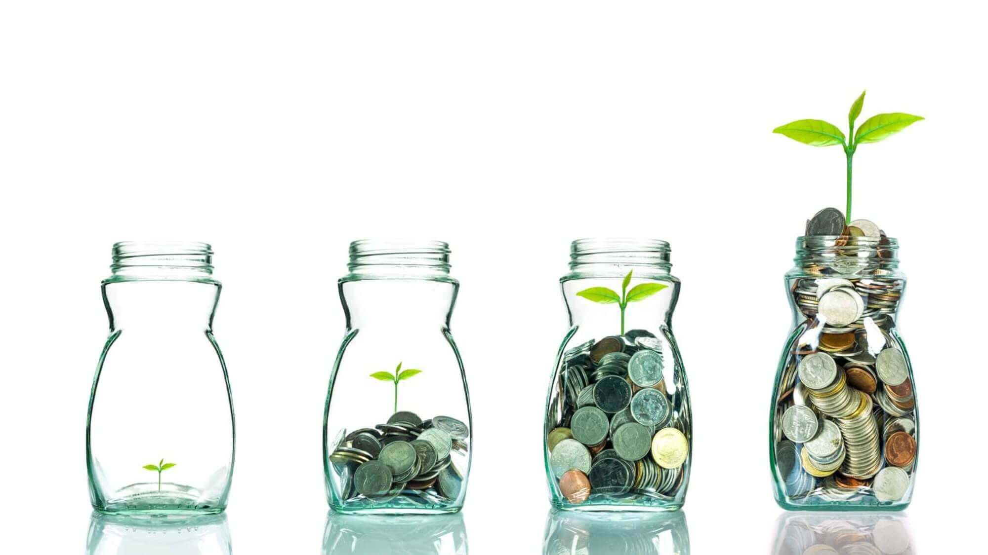 4 glass jars filling up with coins in the way hotels will start to fill up again in the future