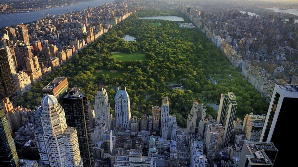 new york skyline with apartments, hotel properties and central park