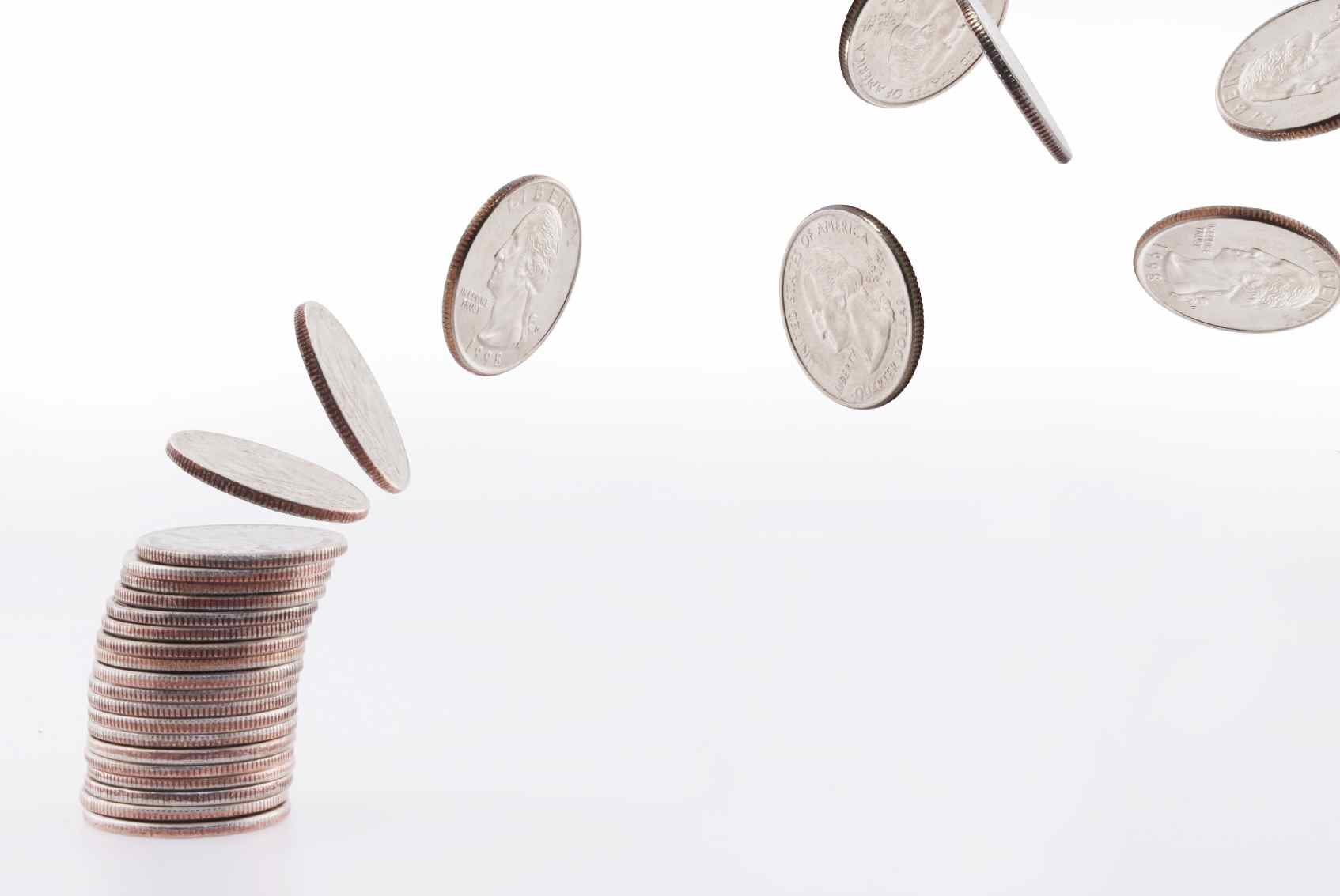 stack of coins with some flying off reflecting challenges for hotels around their adr
