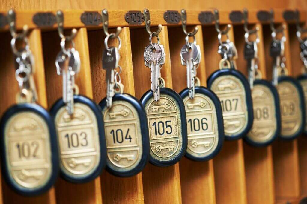 hotel keys hanging on pegs reflecting mixed occupancy levels during crisis
