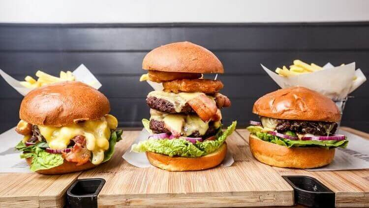 different sizes of burgers showing different fillings like different attributes of a hotel room