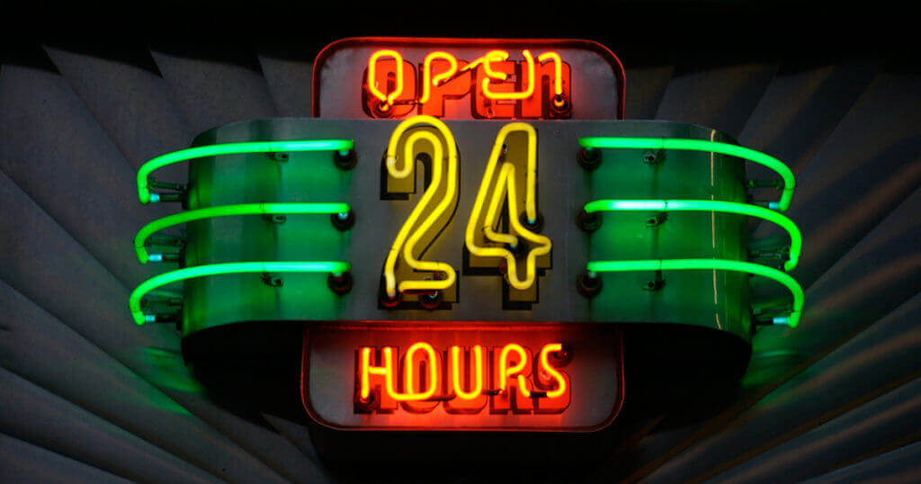 open 24 hours neon sign showing brand hotels need marketing budget to let customers know they are open