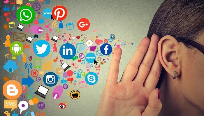 lady with hand to her ear and social media logos near by to depict her listening to social channels
