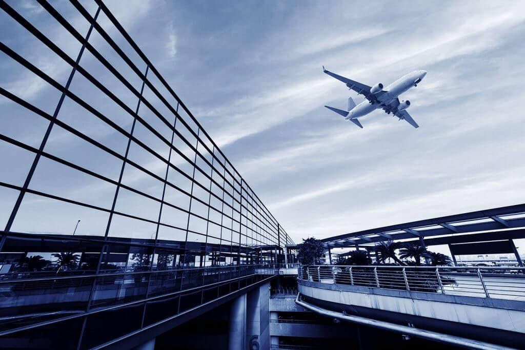 plane flying as people look to travel post lockdown
