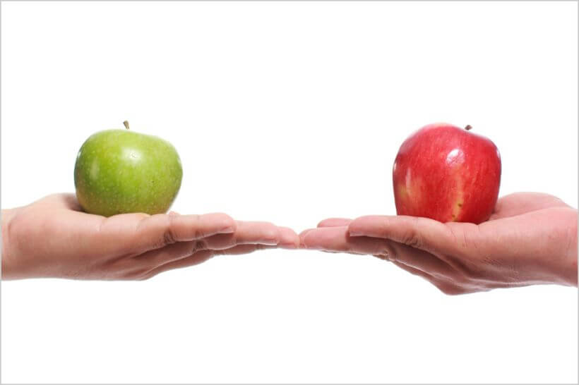 two apples of different colours showing how local hotels need to differentiate online