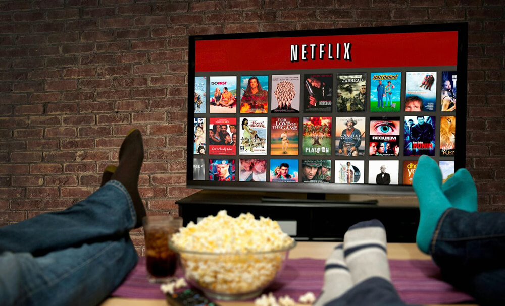 people watching netflix on tv with popcorn