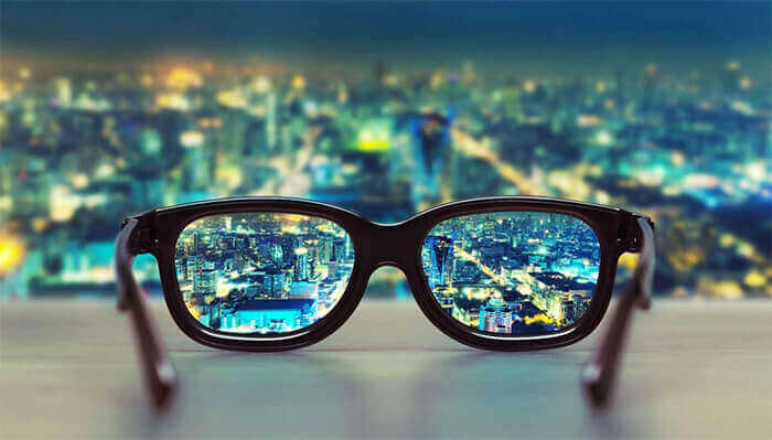 clear vision through glasses reflecting hotel trends to view in 2021