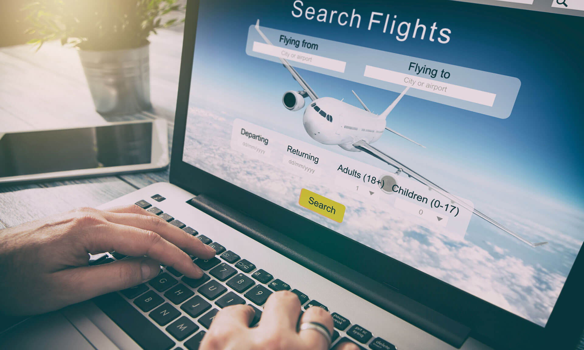 person using metasearch site to research flight and hotel options