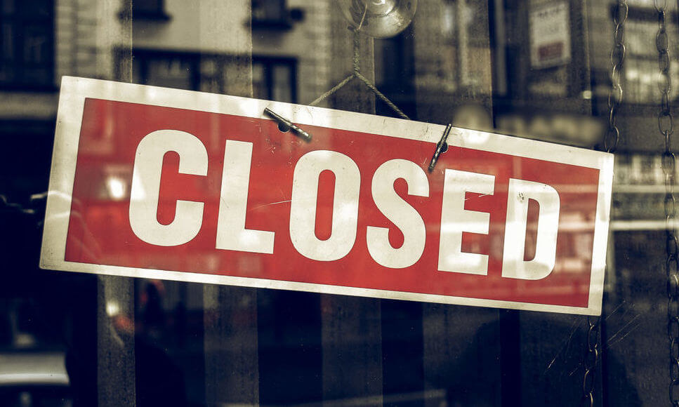 closed sign on hotel door due to covid lockdown
