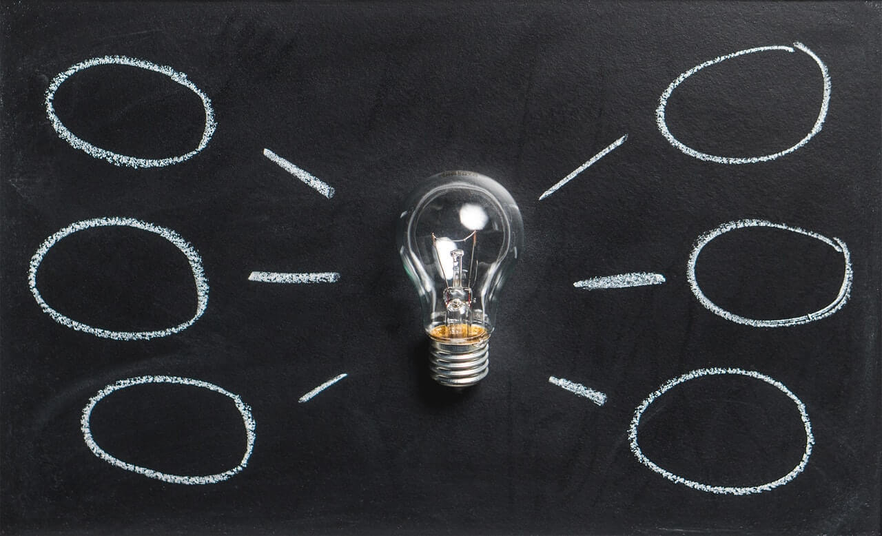 lightbulb linked by many elements including data and analytics