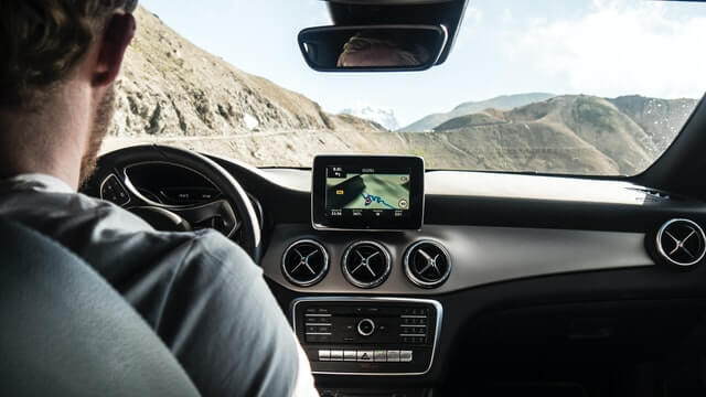 view out of car with satnav depicting how setting your room price automatically works better