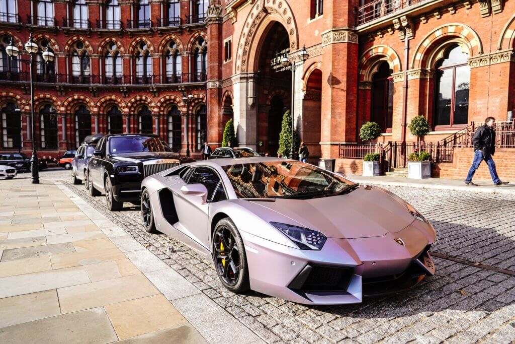 luxury guest cars outside a hotel