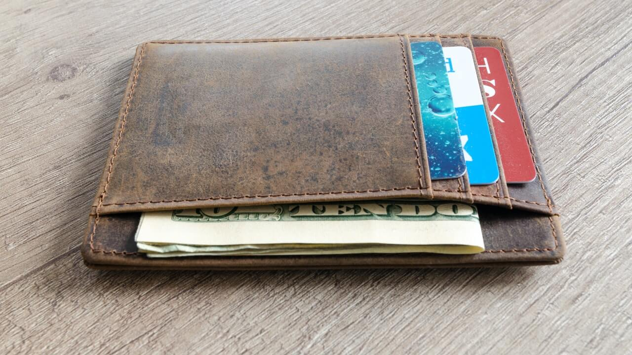 wallet with money and cards reflecting revenue management drive to increase share of wallet per guest